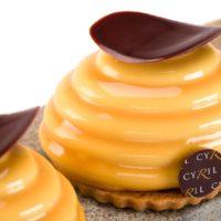 Bizcocho Pain de Gêne de naranja Cremoso de naranja Bavaroise perfumada con café en grano Masa especuloos Glaseado oro. Sugerencia: comer frío. $4,70